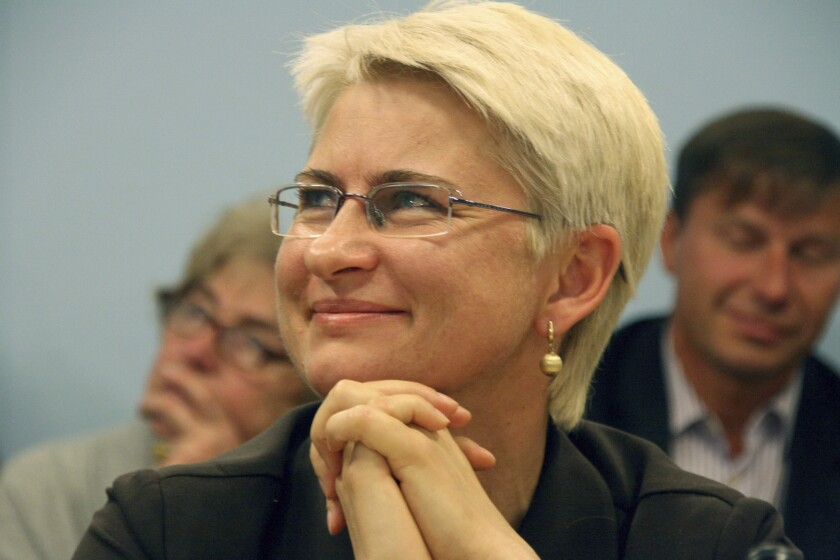 FILE - This 2012 photo provided by Juozas Valiusaitis shows Neringa Venckiene in Lithuania. A family member says the U.S. extradition appears to be underway for Venckiene, a former Lithuanian judge who faces charges in her homeland tied to her claims a ring of pedophiles victimized her 4-year-old niece. Her son tells The Associated Press that his mother messaged him Tuesday, Nov. 5, 2019, to say jail guards in Chicago ordered her to gather her belongings and that she was being taken away. The son, Karolis Venckus, said that could only mean the extradition process has begun. (photo courtesy Juozas Valiusaitis via AP File)