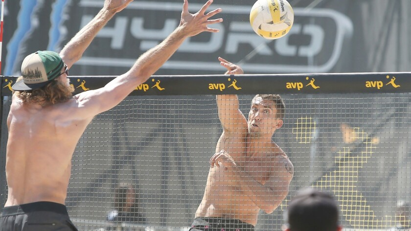 Trevor Crabb puts the ball past the block of Jeremy Casebeer during day two of the AVP Huntington Be