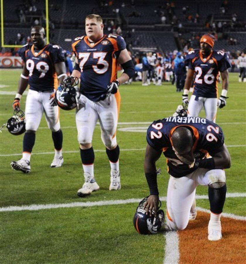 Denver Broncos' Elvis Dumervil (92) kneels on the ground after the Broncos lost to the San Diego Chargers in their NFL football game, Sunday, Nov. 22, 2009, in Denver. The Chargers defeated the Broncos 32-3. (AP Photo/Chris Schneider)