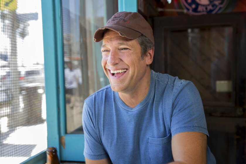 """In this Aug. 21, 2014 photo released by CNN, Mike Rowe appear in a promotional shoot for the series """"Somebody's Gotta Do It,"""" in Venice, Calif. Rowe's new travelogue program, """"Somebody's Gotta Do It,"""" is a key part of CNN's strategy for the future. It debuts Wednesday, Oct. 8, at 9 p.m. EDT. (AP Photo/CNN, Jeremy Freeman)"""