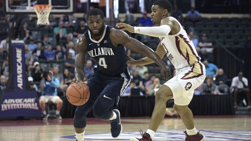 Villanova forward Eric Paschall (4) drives past Florida State guard M.J. Walker (23) during the firs