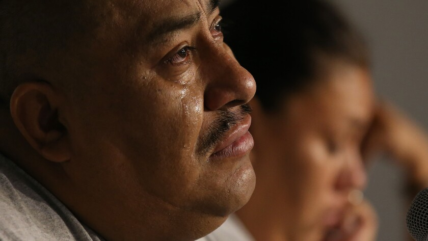 Juan Mendez, the father of Jose Peruzzi Mendez, tears up as he talks about his son during a community meeting in 2016.
