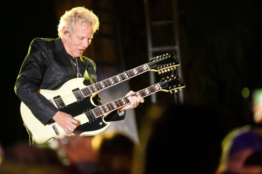 Promises2Kids 2019 gala Don Felder with two-neck guitar.jpg