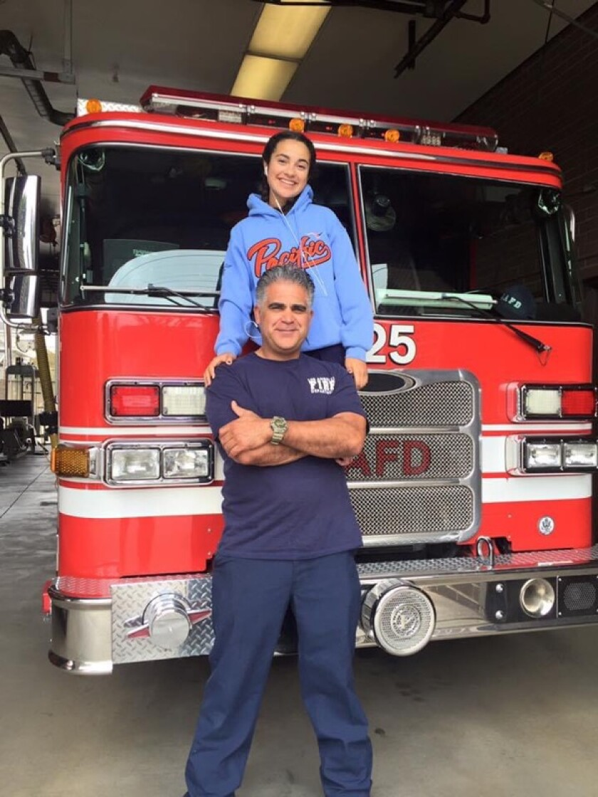 LAFD firefighter and paramedic Francisco Aguilar with one of his daughters, Bella.