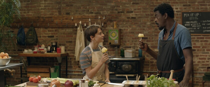 Noah Schnapp, left, and Seu Jorge in the movie 'Abe'
