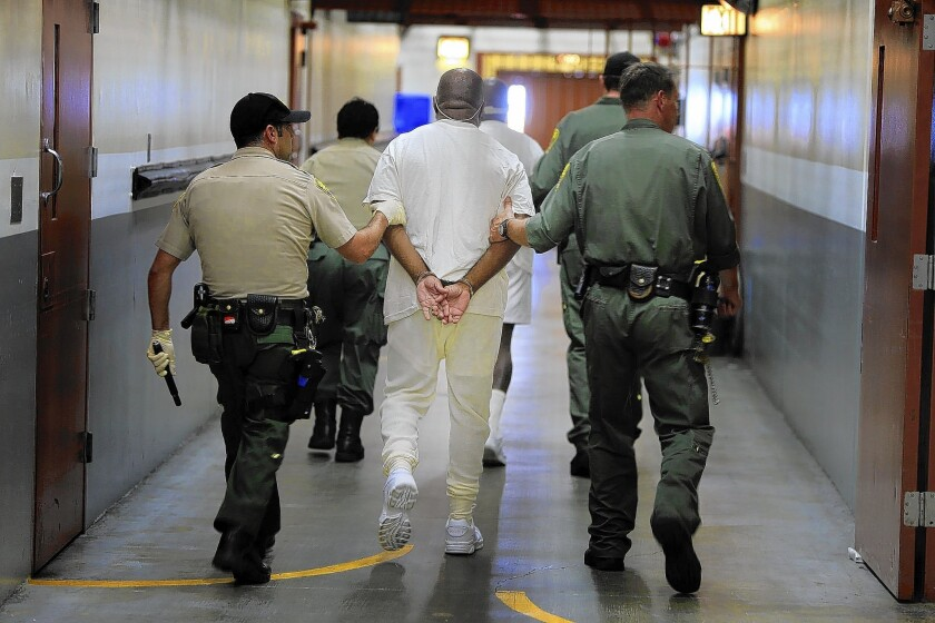 Two inmates are walked from their cells to the medical unit at Pelican Bay State Prison in Crescent City. State prison officials adopted new policies addressing use of force against mentally ill inmates.
