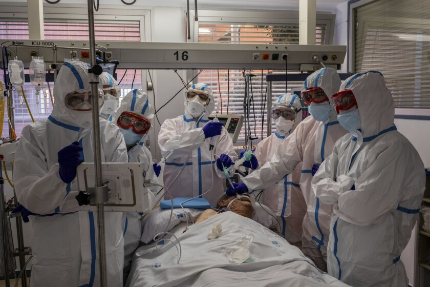 A COVID-19 patient is treated in an intensive care unit in Leganes, Spain.