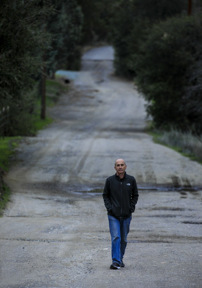 JULIAN, CA., FEB 1, 2019: Thriller/crime novelist Don Winslow down a road in North Eastern San Dieg