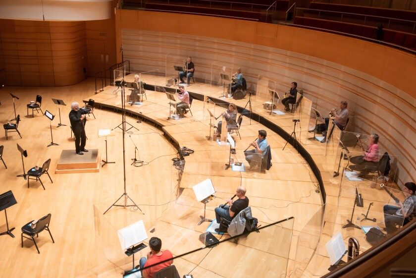 The brass and wind section of the Pacific Symphony rehearses for the filming of the online series Symphony Thursdays.