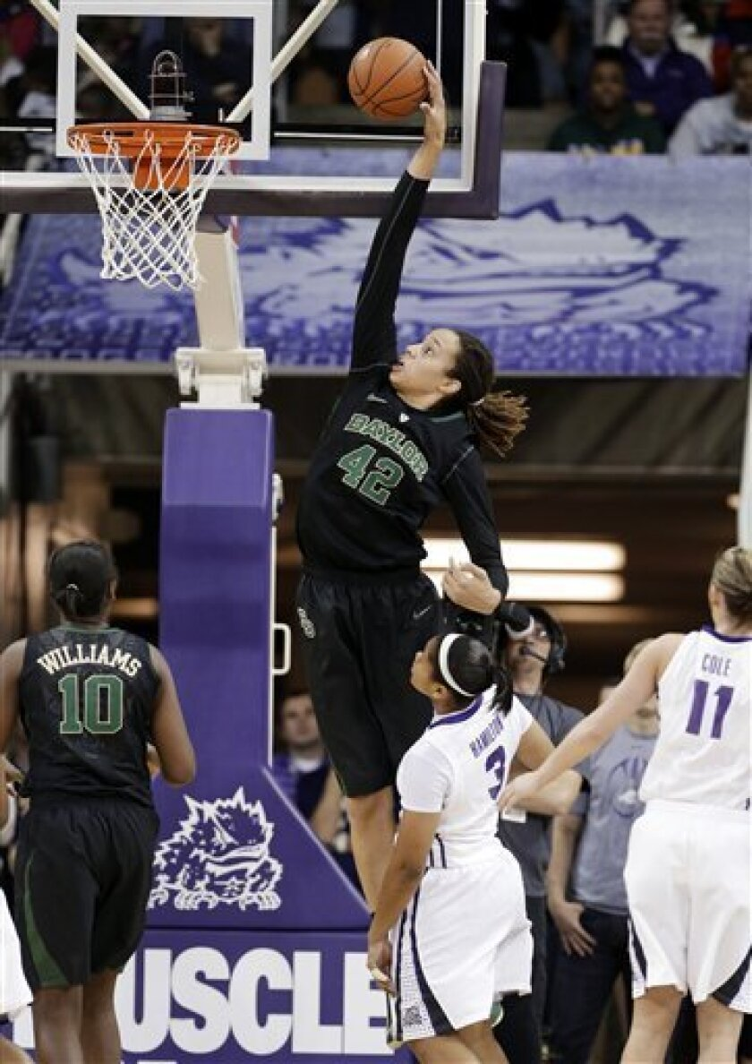 Baylor center Brittney Griner (42) dunks as Destiny Williams (10), TCU's Veja Hamilton, center, and Kamy Cole (11) watch in the first half of an NCAA college basketball game, Wednesday, Jan. 2, 2013, in Fort Worth, Texas. (AP Photo/Tony Gutierrez)