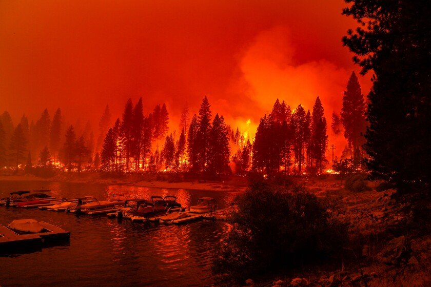 A wildfire approaches a lake