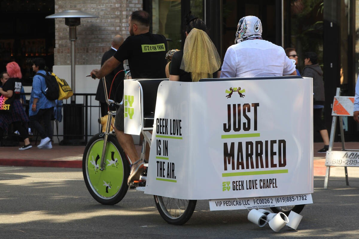 SAN DIEGO, July 20, 2017 | Jill and David Lira, who have been married ten years, ride off in a pedicab after renewing their wedding vows at the SYFY Geek Love Chapel on 5th Avenue in downtown San Diego on Thursday. | Photo by Hayne Palmour IV/San Diego Union-Tribune/Mandatory Credit: HAYNE PALMOUR IV/SAN DIEGO UNION-TRIBUNE/ZUMA PRESS San Diego Union-Tribune Photo by Hayne Palmour IV copyright 2017