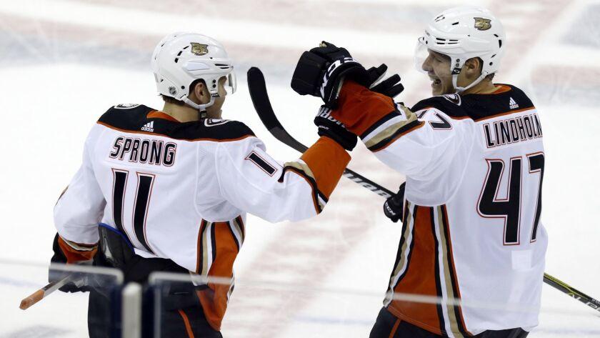 Anaheim Ducks forward Daniel Sprong, left, of the Netherlands, and teammate defenseman Hampus Lindho