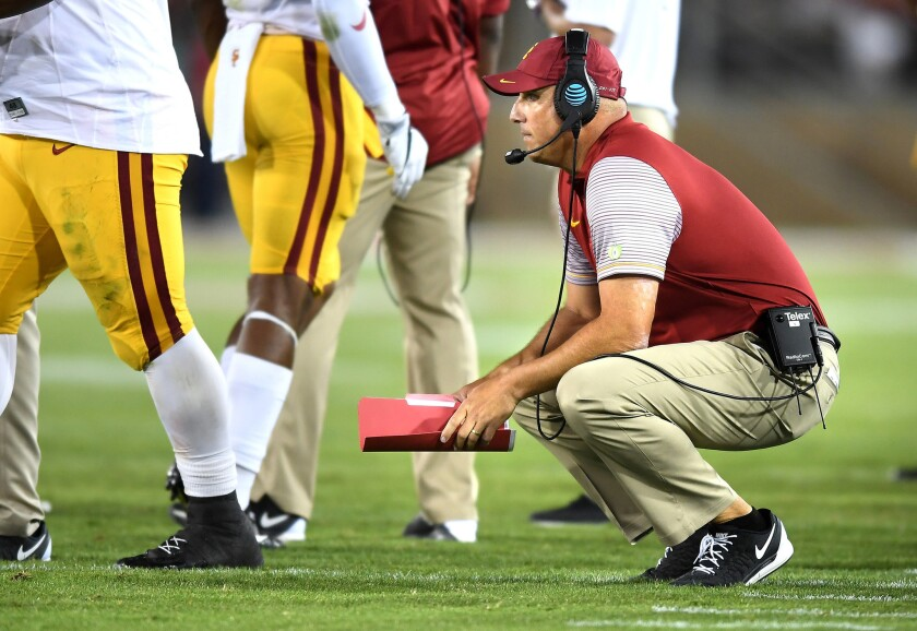 Coach Clay Helton reacts after the Trojans turned the ball over on downs to the Cardinal late in the game.