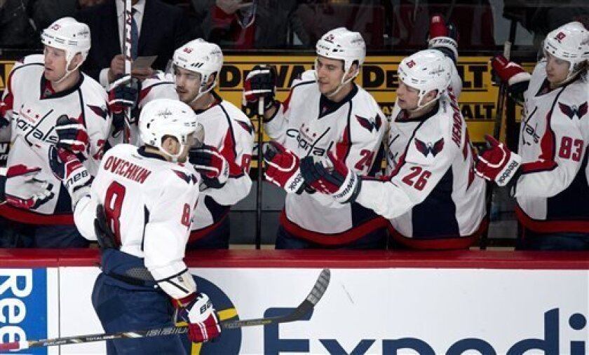 Washington Capitals' Alex Ovechkin is congratulated by teammates following a goal against the Montreal Canadiens during second period NHL hockey action Tuesday, April 9, 2013 in Montreal. (AP Photo/The Canadian Press, Paul Chiasson)