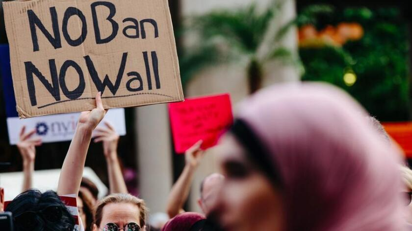 Protesters rally against the Trump travel ban in New York in June.