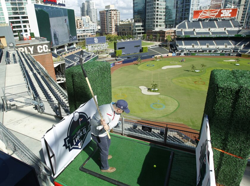 Glenn Hickey tees off on the 7th hole with a hockey stick at The Links at Petco Park, a nine hole golf course constructed throughout the stadium.