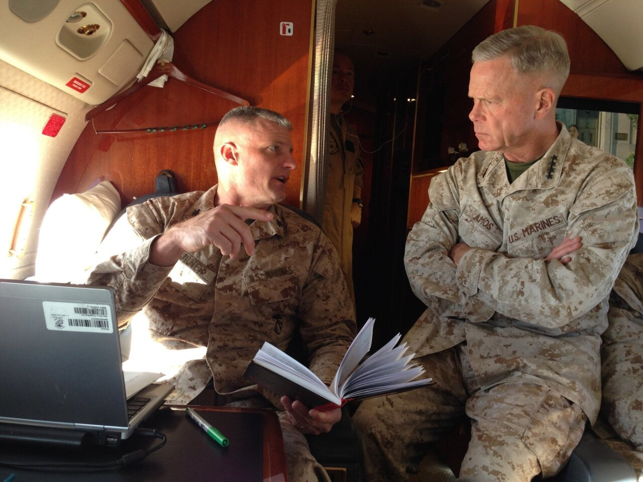 Col. Roger Turner, left, briefs Gen. James Amos on the flight to Afghanistan.  (Gretel C. Kovach/U-T San Diego)