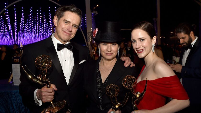 """Amy Sherman-Palladino, center, is flanked by Daniel Palladino and Rachel Brosnahan of """"The Marvelous Mrs. Maisel"""" at the 70th Emmy Awards Governors Ball."""