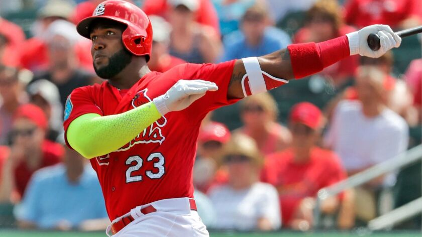 St. Louis Cardinals' Marcell Ozuna watches his solo home run during the second inning of an exhibiti