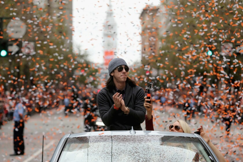 Tim Lincecum basks in the cheers of the crowd during the 2012 victory parade for the San Francisco Giants.