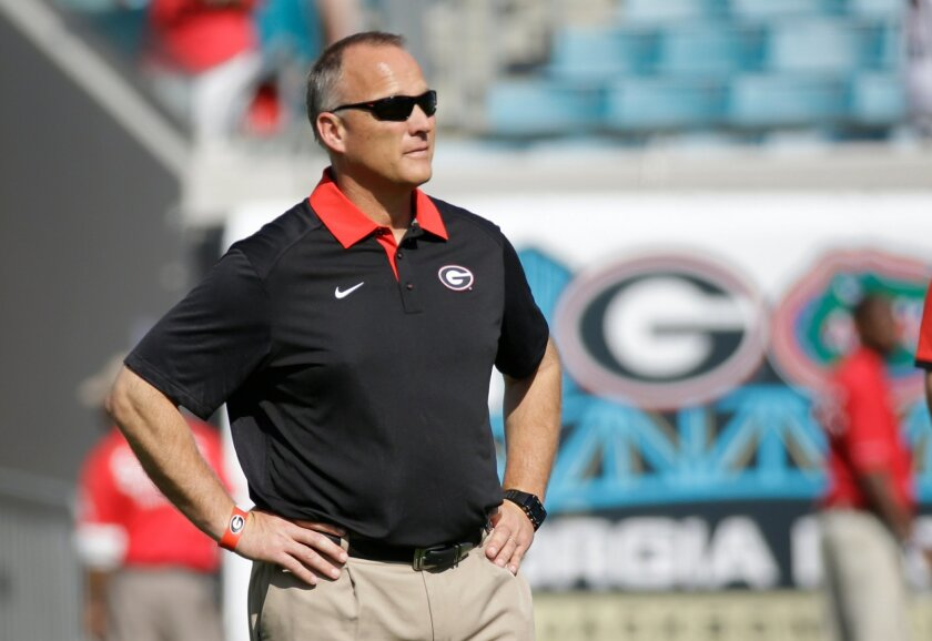 FILE - In this Oct. 31, 2015, file photo, Georgia head coach Mark Richt watches his team warm up before an NCAA college football game against Florida, in Jacksonville, Fla. Losses in three of four games, including last week's ugly loss at Florida, have turned up the heat on Georgia coach Mark Richt