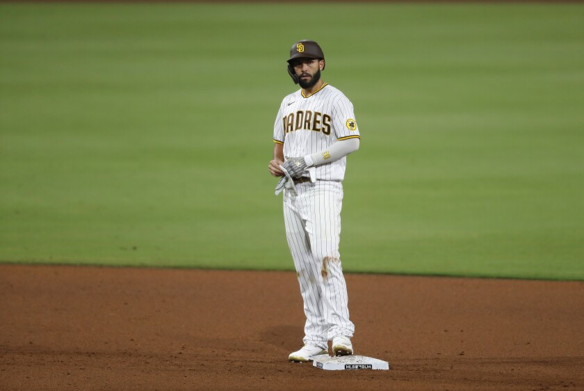 Padres Eric Hosmer stands on second base after his second 3-run double on opening day against the Diamondbacks.