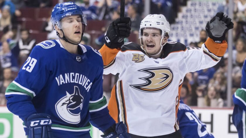 Anaheim Ducks' Sam Steel, right, celebrates teammate Kiefer Sherwood's goal as Vancouver Canucks Ash