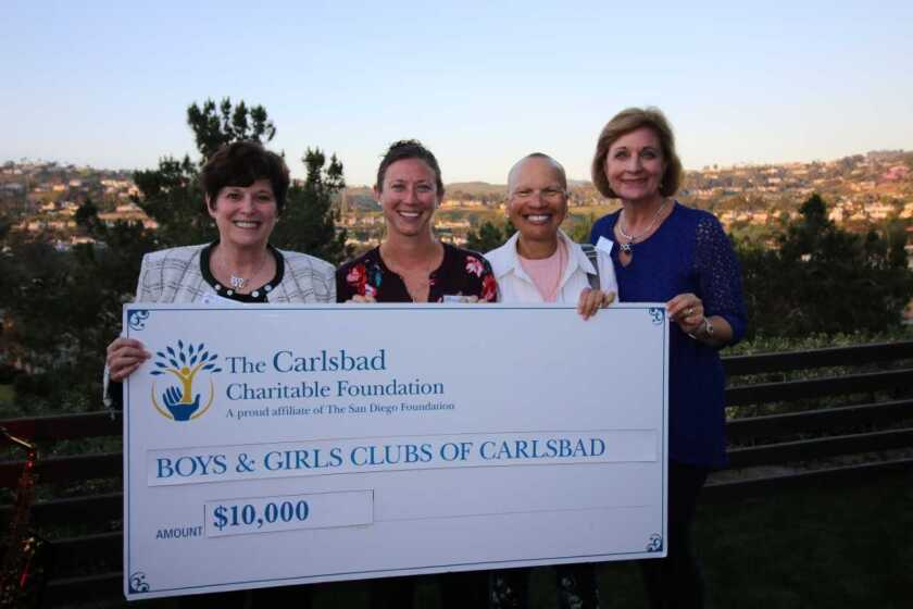 Four nonprofits serving Carlsbad received grants totaling $73,000 from the Carlsbad Charitable Foundation, an affiliate of The San Diego Foundation. The grants ranged from $10,000 to $30,000 and are earmarked for programs that will strengthen community ties among local youths and senior citizens and build intergenerational mentorships. The four grants included a $25,000 contribution from the San Diego Foundation Age-Friendly Communities Program. A $30,000 grant went to the San Diego Dance Theater for the Intergenerational Dance Program in Carlsbad; Carlsbad-based nonprofit Kids for Peace received an $18,000 grant for the Grandfriends Kindness Project; a $15,000 grant went to Carlsbad-based New Village Arts; and Boys & Girls Clubs of Carlsbad received a $10,000 grant for the Rancho Carlsbad Garden Mentoring Program. (left to right) The San Diego Foundation Incoming Board Chair P. Kay Coleman, Boys & Girls Club of Carlsbad Teen Director Liz Hopley, The San Diego Foundation Board Member Donna Marie Robinson, and Carlsbad Charitable Foundation Board Chair Sandy Lund pose for a photo as the Carlsbad Charitable Foundation presents a grant check to the Boys & Girls Club. Visit sdfoundation.org.
