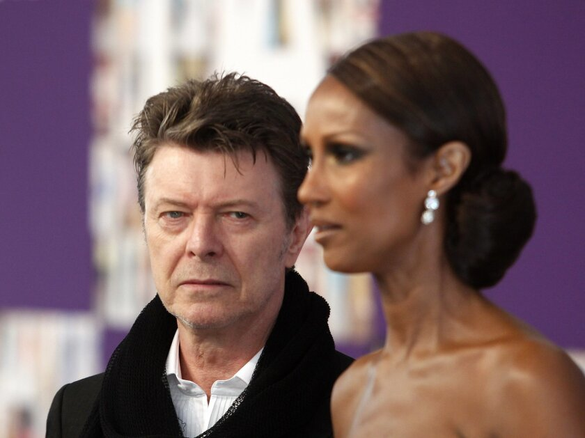 FILE - In this Monday, June 7, 2010, file photo David Bowie and Iman attend the 2010 CFDA Fashion Awards in New York. (AP Photo/Peter Kramer, File)
