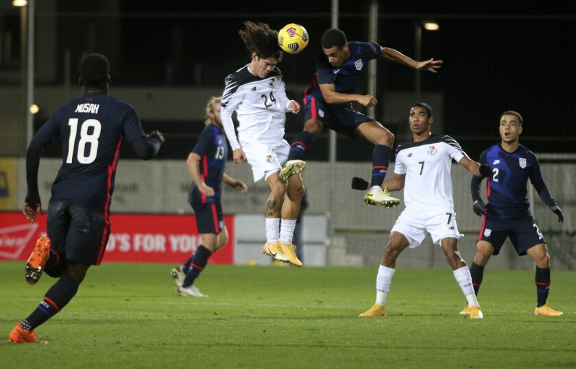Panama's Juan David Tejada, left, and United States' Tyler Adams leap to head the ball during Monday's match.