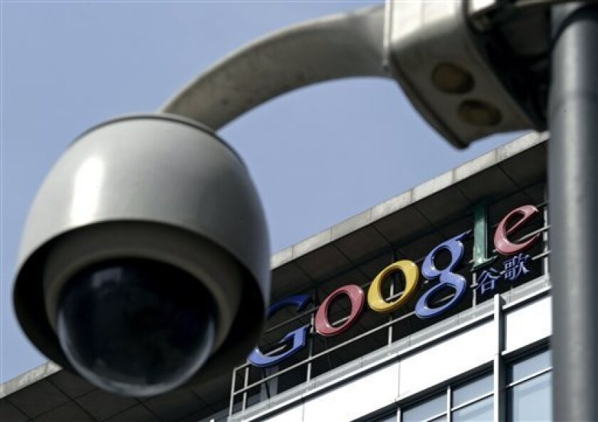 FILE - In this March 23, 2010 file photo, a surveillance camera is seen in front of the Google China headquarters in Beijing, China. Google Inc. said one of its Web search features was blocked in China on Thursday, July 1, 2010 as the company awaited Beijing's decision on whether to renew its operating license in their latest skirmish over censorship. (AP Photo/Andy Wong, File)