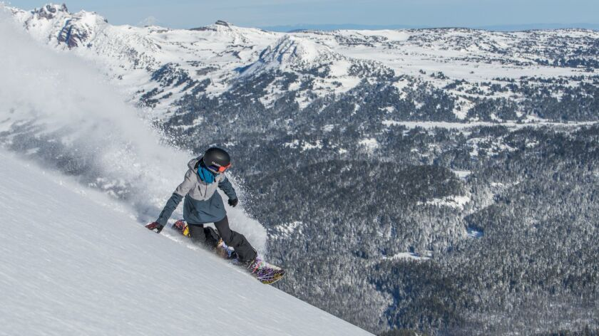 BEND, OREG. -- A snowboarder shreds the slopes at Mt. Bachelor, one of the largest ski areas in the