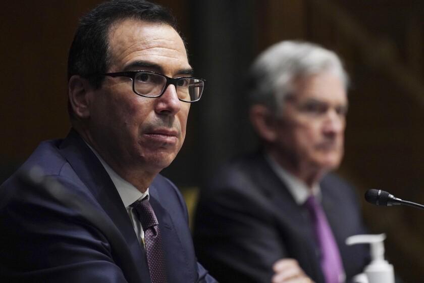 Federal Reserve Chair Jerome Powell, right, and Treasury Secretary Steve Mnuchin