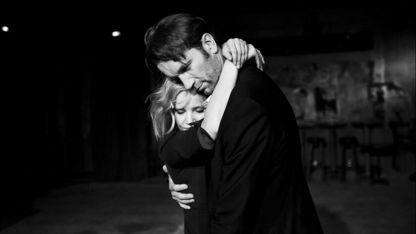 """This image released by Amazon Studios shows Joanna Kulig, left, and Tomasz Kot in a scene from """"Cold"""