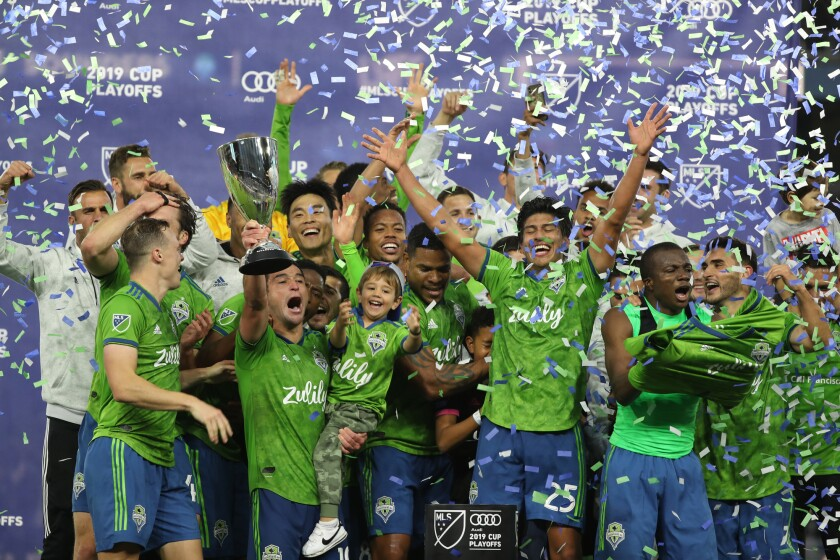 The Seattle Sounders celebrate their victory.
