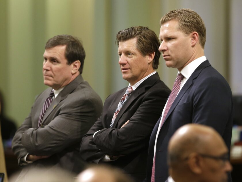 GOP Assemblymen Scott Wilk, left, Brian Jones and Minority Leader Chad Mayes listen during a debate at the Capitol.