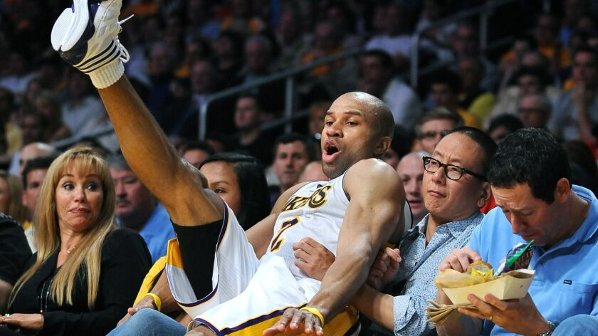 Appetize's founders were frustrated that they couldn't use an app to get food delivered to their seats at Staples Center during a Lakers game in 2011. So they invented one. Above, Derek Fisher falls into the seats after chasing a loose ball in a 2011 game against the Hornets.
