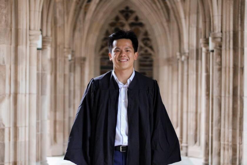 Bryant Huang in his graduation robe at Duke University.