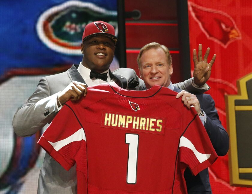 Florida offensive lineman D.J. Humphries poses for photos with NFL commissioner Roger Goodell after being selected by the Arizona Cardinals as the 24th pick in the first round of the 2015 NFL Draft,  Thursday, April 30, 2015, in Chicago. (AP Photo/Charles Rex Arbogast)
