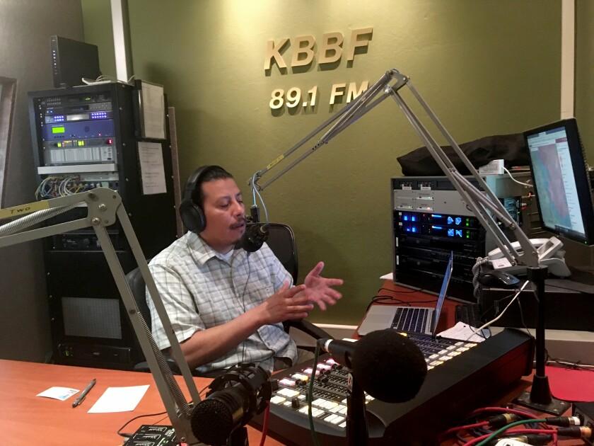 Rafael Vazquez, a volunteer at KBBF-FM