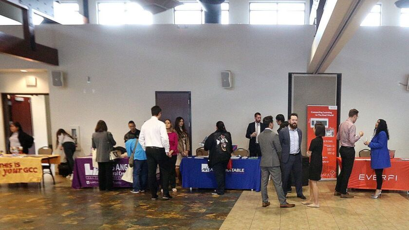 One side of a ring of tables, all related to local finance businesses, at the Glendale Unified Schoo