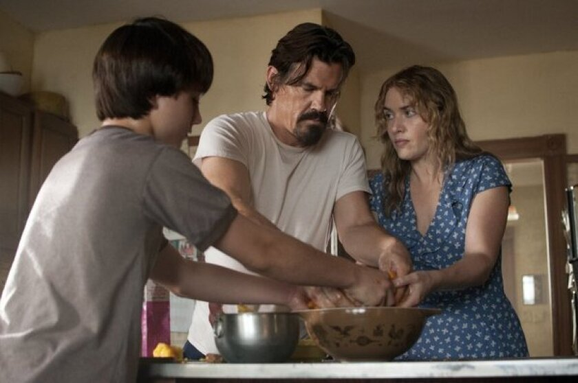 "Gattlin Griffith is Henry, left, Josh Brolin is Frank and Kate Winslet is Adele in the movie ""Labor Day."""