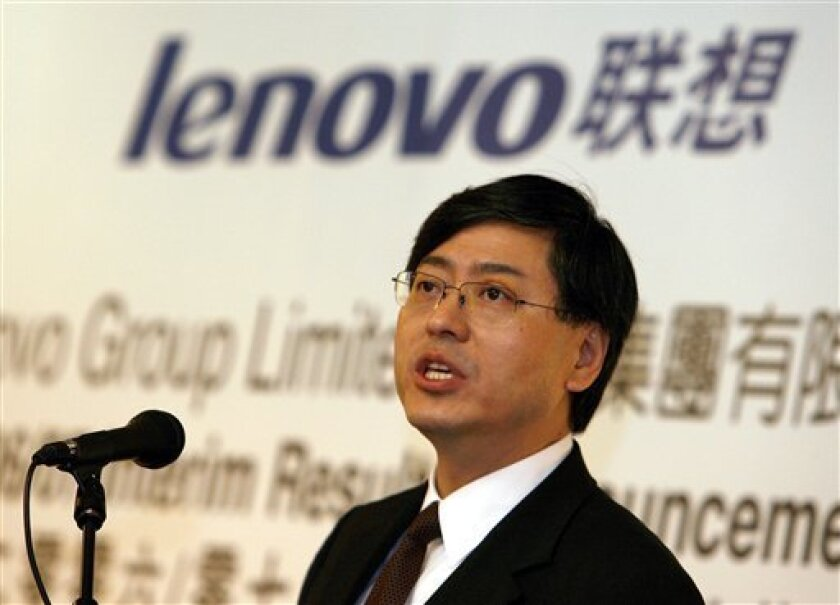 In this Nov. 9, 2006 file photo, Lenovo Group Ltd. Chairman Yang Yuanqing speaks during a press conference in Hong Kong. PC maker Lenovo Group announced a $96.7 million quarterly loss Thursday, Feb. 5, 2009, due to a drop in sales amid global turmoil and said CEO William J. Amelio resigned in a management reshuffle. (AP Photo/Vincent Yu, File)