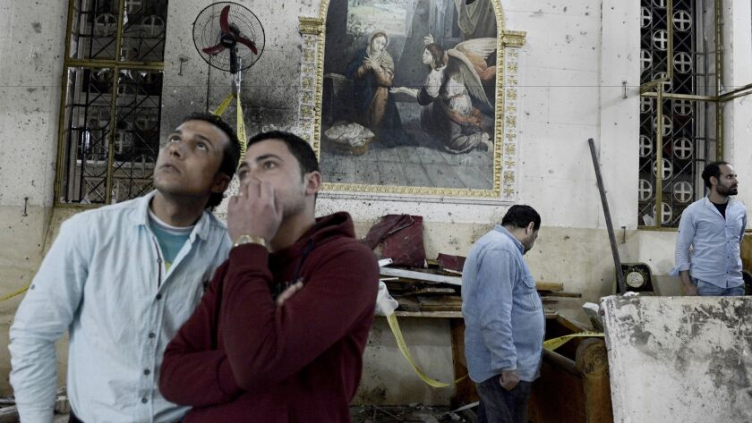 Friends and relatives of victims at St. George's Church in Tanta, Egypt, following the explosion.