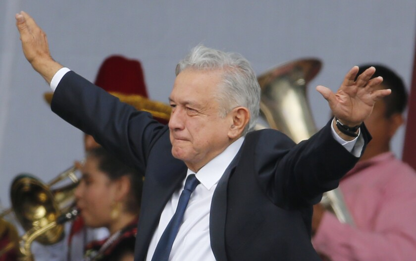 Mexico's President Andres Manuel Lopez Obrador arrives at a rally  July 1 to celebrate the anniversary of his election, in Mexico City's Zocalo square.