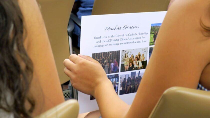 Spanish visiting students presented a photographic keepsake Tuesday to members of the La Canada Flin