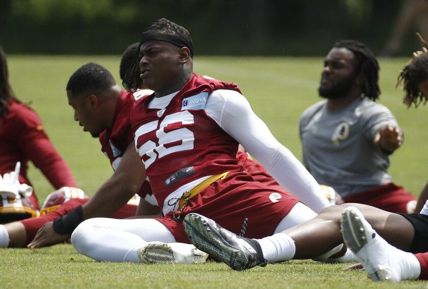 FILE - Washington Redskins linebacker Reuben Foster stretches during a practice at the team's NFL football practice facility, in a Reuben Foster Monday, May 20, 2019 file photo, in Ashburn, Va.The Washington Football Team activated linebacker Reuben Foster off the physically unable to perform list Sunday, Aug.9, 2020. The team made the move days ahead of the start of on-field training camp workouts. (AP Photo/Patrick Semansky, File)