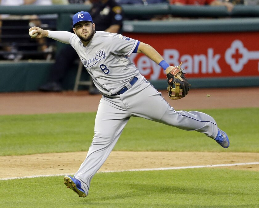 FILE - In this Tuesday, July 28, 2015 file photo, Kansas City Royals' Mike Moustakas looks but can't make the throw to first base to get Cleveland Indians' Carlos Santana out in the fifth inning of a baseball game in Cleveland. The Royals and third baseman Mike Moustakas have agreed to a $14.3 mill