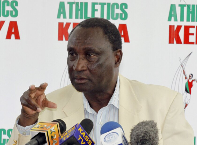 """FILE - In this Friday, Dec. 19, 2014 file photo, Athletics Kenya President Isaiah Kiplagat addresses the media during a press conference in Nairobi, Kenya. The IAAF ethics commission on Monday Nov. 30, 2015 suspended three senior Kenyan track and field federation officials over the """"potential subversion"""" of the anti-doping system in the east African nation. The IAAF said Athletics Kenya President Isaiah Kiplagat, vice president David Okeyo, who is also an IAAF Council member, and 2015 world championships team leader Joseph Kinyua have been suspended for 180 days """"in the interests of the integrity of the sport."""" (AP Photo/Khalil Senosi, File)"""